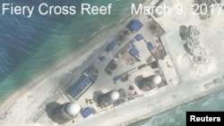 Construction is shown on Fiery Cross Reef, in the Spratly Islands, the disputed South China Sea in this March 9, 2017, satellite image released by CSIS Asia Maritime Transparency Initiative at the Center for Strategic and International Studies (CSIS)
