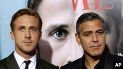 "Director, writer, and cast member George Clooney, and cast member Ryan Gosling at the premiere of ""The Ides of March"" which won for Best Adapted Screenplay. (AP PHOTO)"