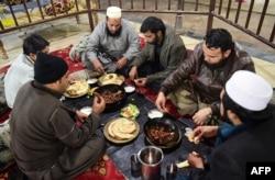 Pakistani customers eat grilled meat at the Charsi (Hashish) Tikka restaurant in Namak Mandi in Peshawar, Dec. 6, 2018.