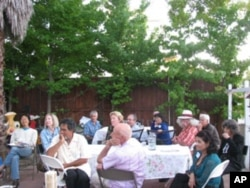 Guests gather for a meal at the home of American Muslim Voice founder Samina Sundas.