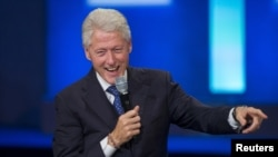 FILE - A poll indicates former U.S. President Bill Clinton could be a help to Hillary Clinton in the Democratic primary but a hindrance to her in the general election. He's shown at the Clinton Global Initiative's annual meeting in New York, Sept. 29, 2015.