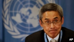 FILE - Then-U.N. human rights investigator Vitit Muntarbhorn gestures during a press conference at United Nations headquarters in Geneva, Switzerland, March 15, 2010.