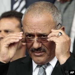 Yemen's President Ali Abdullah Saleh adjusts his glasses during a rally in Sanaa, Apr 22 2011