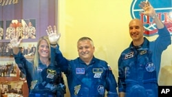 Members of the next mission to the International Space Station, from left: U.S. astronaut Karen Nyberg, Russian cosmonaut Fyodor Yurchikhin, and European Space Agency astronaut Luca Parmitano at Baikonur cosmodrome, Kazakhstan, May 27, 2013.