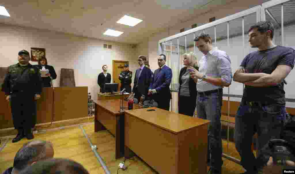 Russian opposition leader and anti-corruption blogger Alexei Navalny and his brother and co-defendant Oleg attend a court hearing in Moscow, Dec. 30, 2014.