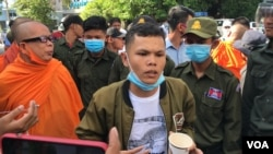 FILE - Thun Ratha, an activist of Mother Nature Cambodia, takes part in a protest at a Caltex gasoline station in Phnom Penh, Cambodia, on July 8, 2020. (Hul Reaksmey/VOA Khmer)