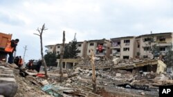 Rescue workers are seen at the scene of a traffic police station and lodging quarters attacked with a car bomb by Kurdish rebels, in Nusaybin, southeastern Turkey, March 4, 2016.