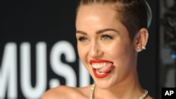 Singer Miley Cyrus seems like she would be good at tongue-in-cheek humor. Here, she is at the 2013 MTV Video Music Awards. (Photo Evan Agostini/Invision/AP)
