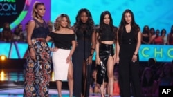 FILE - Dinah Jane Hansen, from left, Ally Brooke, Normani Kordei, Camila Cabello and Lauren Jauregui, of Fifth Harmony, present the Choice Style Icon award at the Teen Choice Awards at the Galen Center in Los Angeles, Aug. 16, 2015.