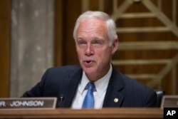 FILE - Sen. Ron Johnson (R-Wisconsin) chairs a hearing on Capitol Hill Washington, Aug. 1, 2017. Johnson is among lawmakers opposed to the Senate tax plan in its current form.