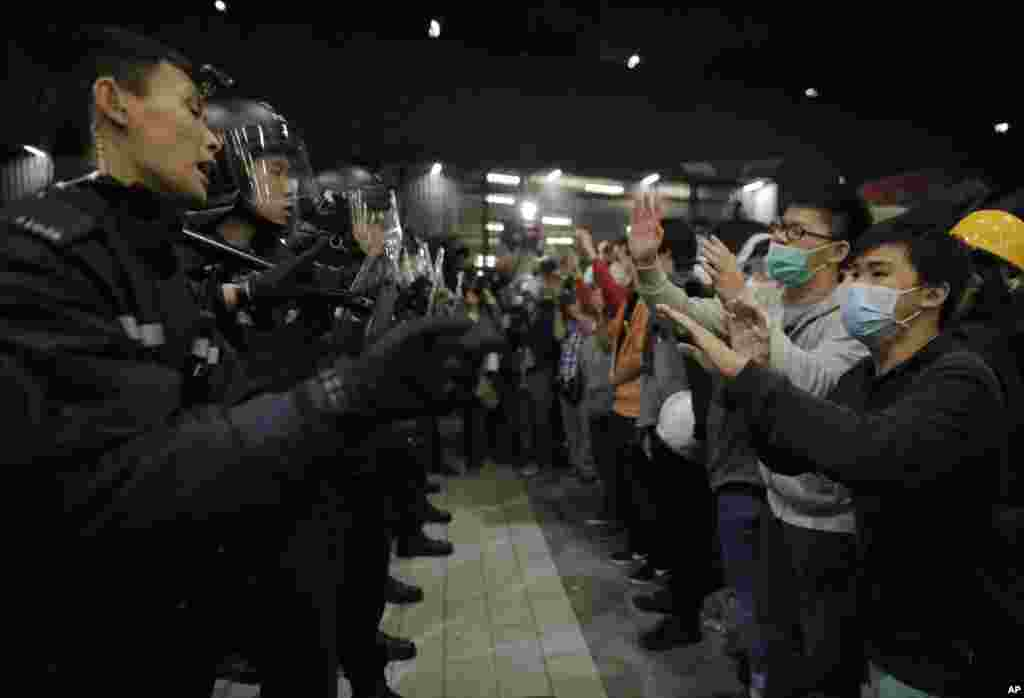Police officers tell the protesters not to push after the protesters tried to break into the Legislative Council in Hong Kong, Nov. 19, 2014.