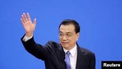中国总理李克强抵达在北京人大会堂全国人大会议闭幕后举行的记者会。(2019年3月15日)
