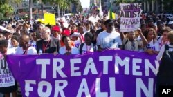 FILE - Civil rights activists march in Durban, South Africa, July 18, 2016 at the start of the 21st World Aids Conference to demand that the fight against HIV/Aids be continued and that funding in the fight against the disease must not be cut.
