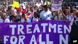 In this file photo, civil rights activists march in Durban, South Africa, July 18, 2016 at the start of the 21st World Aids Conference.