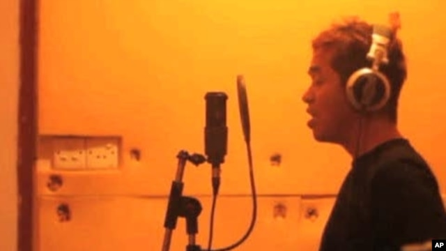 Darko C of the Burmese band Side Effect records vocal tracks.