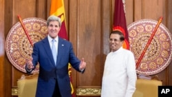 FILE - U.S. Secretary of State John Kerry, center left, poses with Sri Lankan President Maithripala Sirisena before a meeting in the presidential meeting room at the Presidential Secretariat, Saturday, May 2, 2015, in Colombo, Sri Lanka.