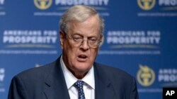 FILE - David Koch speaks in Orlando, Florida, Aug. 30, 2013.
