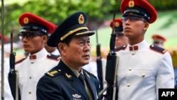 中国国防部长魏凤和上将2019年5月访问新加坡(法新社图片)