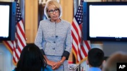 FILE - U.S. Education Secretary Betsy DeVos speaks during a discussion on educational issues, in the Blue Room of the White House in Washington, April 9, 2018.