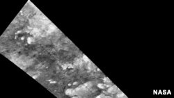 Hundreds of sand dunes are visible as dark lines snaking across the surface.