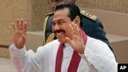 FILE - Sri Lankan President Mahinda Rajapaksa gestures during his swearing-in-ceremony in Colombo, Sri Lanka, Nov. 19, 2010.