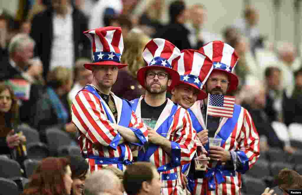 طرفداران تیم آمریکا در مسابقات جهانی راگبی که بازی بین آمریکا و آفریقای جنوبی در انگلیس برگزار می شد. نتیجه ناامید کننده بود. آمریکا 64 بر صفر، باخت.