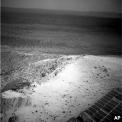 This image sent by NASA's Opportunity rover on Jan. 7, 2015 shows a view from atop a Martian hill.