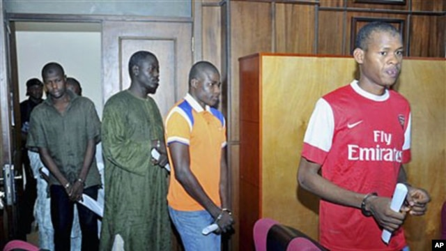 Suspected members of Boko Haram sect enter the federal High court  where they are accused of plotting bombings that killed 25 people, Abuja, September 23, 2011.