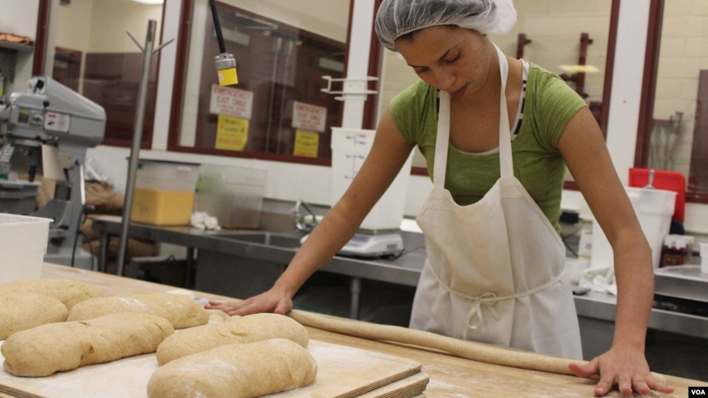 morocco native fatiha outabount 27 shapes dough at the hot bread kitchen bakery in - Hot Bread Kitchen