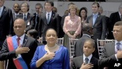 Haiti's President Michel Martelly and family stand for the national anthem during the inauguration ceremony in Port-au-Prince, May 14, 2011