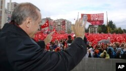 "Turkish President Recep Tayyip Erdogan salutes the crowd of supporters in his hometown of Rize, on the Black Sea coast of Turkey, Oct. 15, 2016. Erdogan said Turkey was moving into Dabiq, Syria, and would declare a ""terror-free safe zone"" in the region."