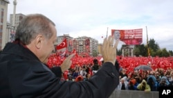 Turkish President Recep Tayyip Erdogan salutes the crowd of supporters in his hometown of Rize, on the Black Sea coast of Turkey, Oct. 15, 2016.