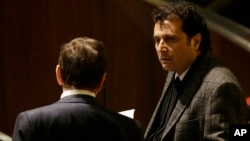 FILE - Francesco Schettino attends his trial at the Grosseto court, Italy, Feb. 11, 2015.