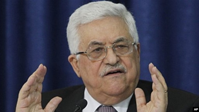 Palestinian President Mahmoud Abbas gestures as he speaks during a press conference with members of the Israeli Peace Initiative in Ramallah, April 28, 2011