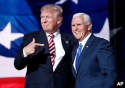 FILE - Republican presidential candidate Donald Trump, points toward Republican vice presidential candidate Indiana Gov. Mike Pence after Pence's acceptance speech during the third day session of the Republican National Convention in Cleveland.
