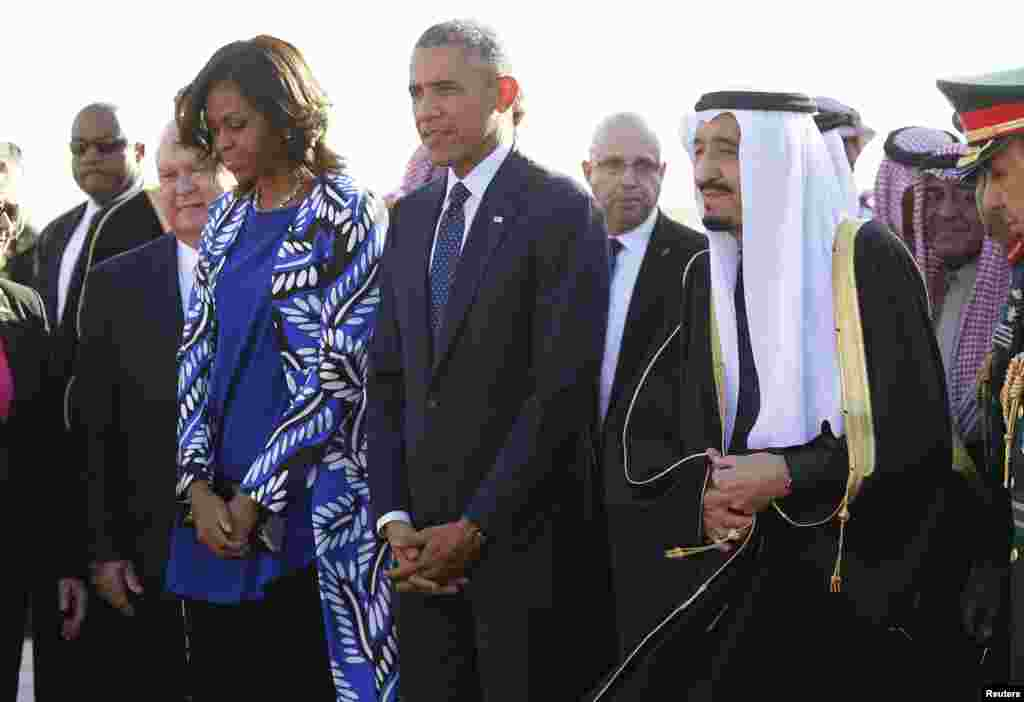 U.S. President Barack Obama and first lady Michelle Obama are greeted by Saudi Arabia's King Salman (R) as they arrive at King Khalid International Airport in Riyadh, Jan. 27, 2015.