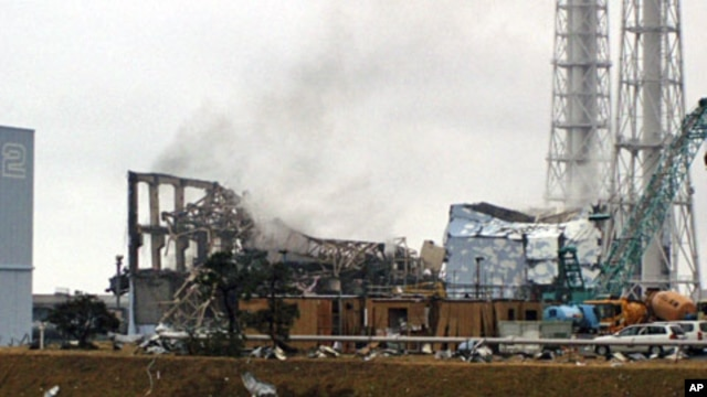 Smoke is seen coming from the area of the No. 3 reactor of the Fukushima Daiichi nuclear power plant in Tomioka, Fukushima Prefecture in northeastern Japan on Mar 21 2011