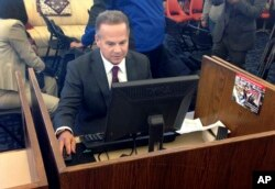 U.S. Rep. David Cicilline completes his test census form on a computer at a library in Providence, R.I., March 26, 2018.