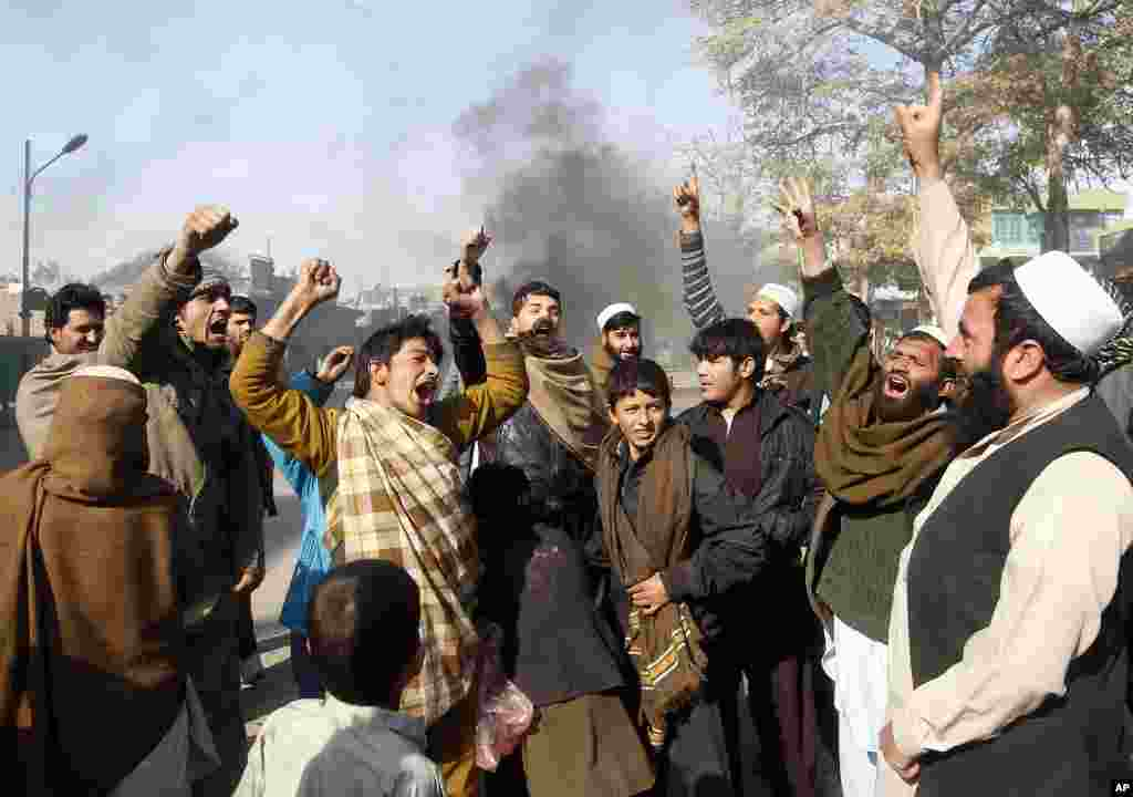 Afghan men shout anti-U.S slogans during a demonstration in Jalalabad province, February 22, 2012. (Reuters)