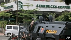 A police armored vehicle is parked outside a Starbucks cafe after an explosion in Jakarta, Indonesia, Jan. 14, 2016.
