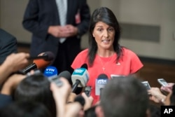 U.S. Ambassador to the United Nations Nikki Haley speaks to reporters after a Security Council vote on a new sanctions resolution that would increase economic pressure on North Korea to return to negotiations on its missile program, Aug. 5, 2017 at U.N. h