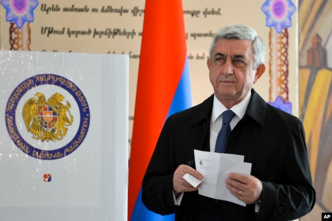FILE - Serzh Sargsyan, Armenia's president at the time, prepares to casts his ballot at a polling station during parliamentary elections, in Yerevan, Armenia, April 2, 2017.