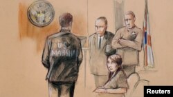 FILE - Yujing Zhang, charged with bluffing her way into President Donald Trump's Florida resort, is seated upon arrival with U.S. Marshals, awaiting the start of her hearing, at the U.S. federal court, in this courtroom sketch, in West Palm Beach, Florida