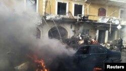 خودرویی سوخته در محل انفجار بمب در شهر عمدتا شیعه نشین هرمل - ۲۶ دی ۱۳۹۲