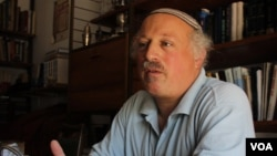 Daniel Pinner in his home in the Israeli settlement of Kfar Tapuach, July 27, 2012, says Israeli sovereignty extends from the Jordan River to the Mediterranean Sea. (VOA/Rebecca Collard).