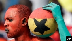 A Ghana supporter painted in his national colors attends the African Cup of Nations in Equatorial Guinea.
