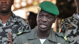 FILE - Malian military junta leader captain Amadou Sanogo speaking at the Kati military camp near Bamako, April 3, 2012.