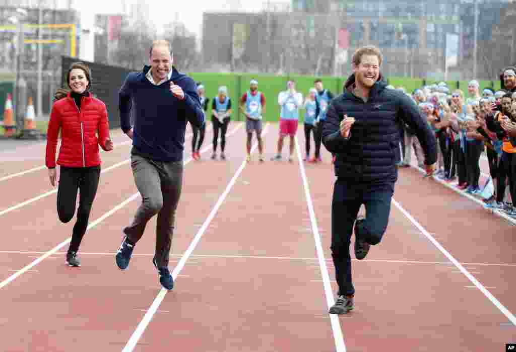 Britain's Prince William, second left, Kate, the Duchess of Cambridge, left, and Prince Harry take part in a relay race, during a training event to promote the charity Heads Together, at the Queen Elizabeth II Park in London.