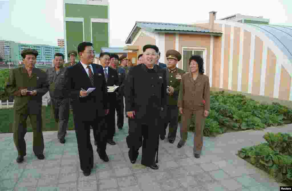 Kim, shown using a cane for support, re-appeared in state media in this undated photo released by North Korea's Korean Central News Agency (KCNA) in Pyongyang on October 14, 2014, after a lengthy public absence that had fuelled speculation over his health and grip on power in the secretive, nuclear-capable country.