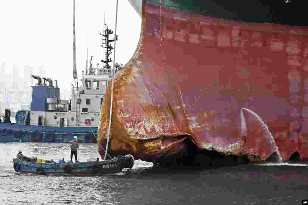 This photo released by Xinhua News Agency shows a view of the damaged part of the Ever Given container ship berthed at a ship-repairing dock of Qingdao Beihai Shipbuilding Heavy Industry Co., Ltd. in Qingdao in eastern China's Shandong Province, Oct. 4, 2021.